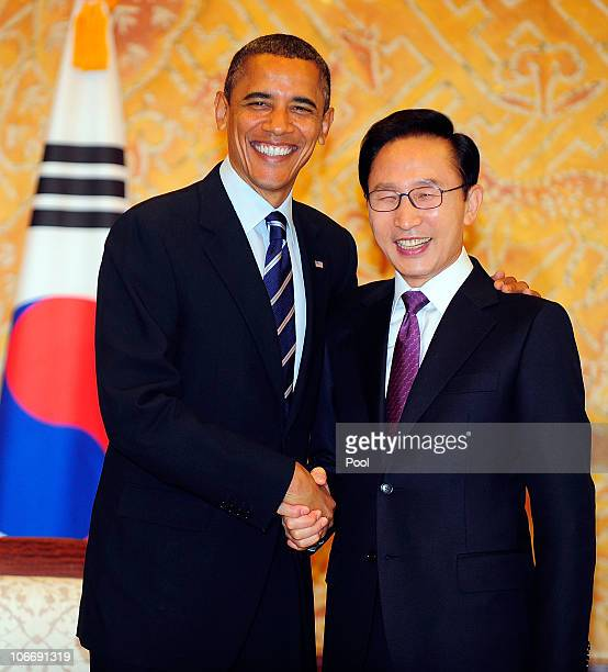 S President Barack Obama shakes hands with South Korean President Lee Myungbak during their bilateral meeting at the Presidential Blue House on...
