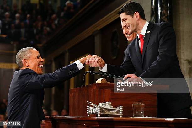 President Barack Obama shakes hands with Speaker of the House Paul Ryan as Vice President Joe Biden looks on before the State of the Union address to...