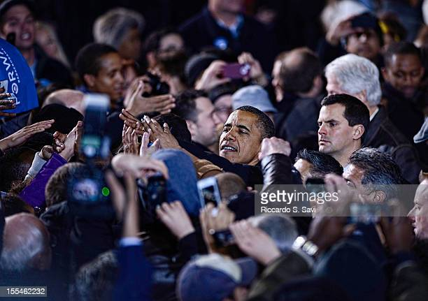 S President Barack Obama shakes hands with supporters at Jiffy Lube Live on November 3 2012 in Bristow Virginia