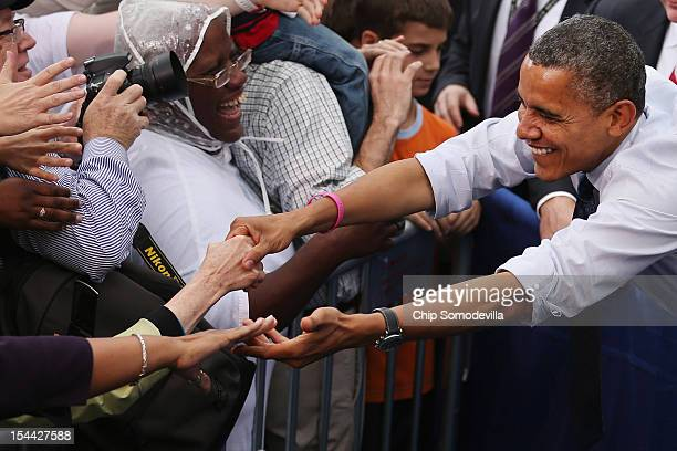 S President Barack Obama shakes hands with supporters during a rally at George Mason University October 19 2012 in Fairfax Virginia Obama and his...
