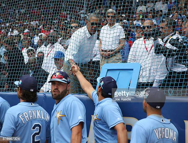 S President Barack Obama shakes hands with Tampa Bay Rays before they take the field in an exhibition game between the Cuban national team and the...