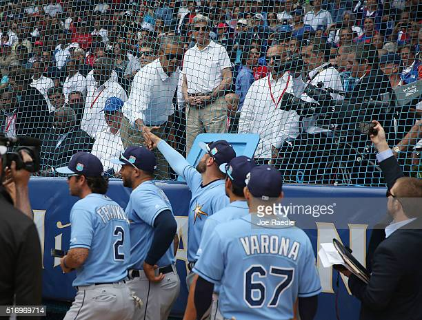S President Barack Obama shakes hands with Tampa Bay Rays players before they take the field in an exhibition game between the Cuban national team...
