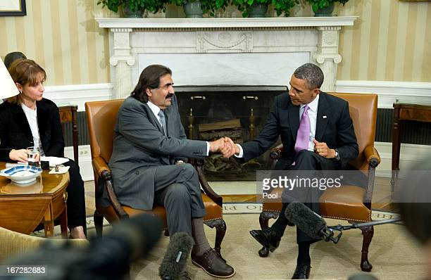 US President Barack Obama shakes hands with the Emir of Qatar Hamad bin Khalifa alThani during a presser in the Oval Office of the White House April...