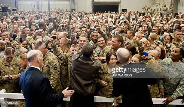 President Barack Obama shakes hands with troops after addressing them at Bagram Air Base in Afghanistan December 3, 2010 during a surprise visit for...