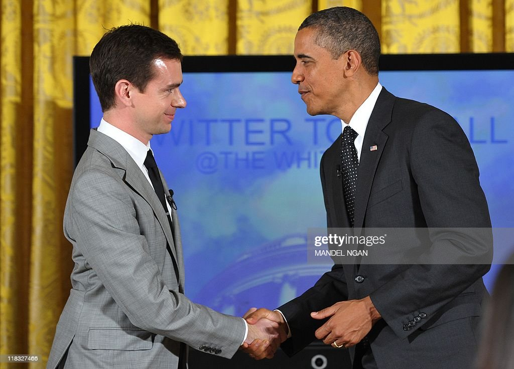 US President Barack Obama shakes hands with Twitter co-founder and Executive Chairman Jack Dorsey after holding a 'Twitter Town Hall' July 6, 2011 in the East Room of the White House in Washington, DC. AFP PHOTO/Mandel NGAN