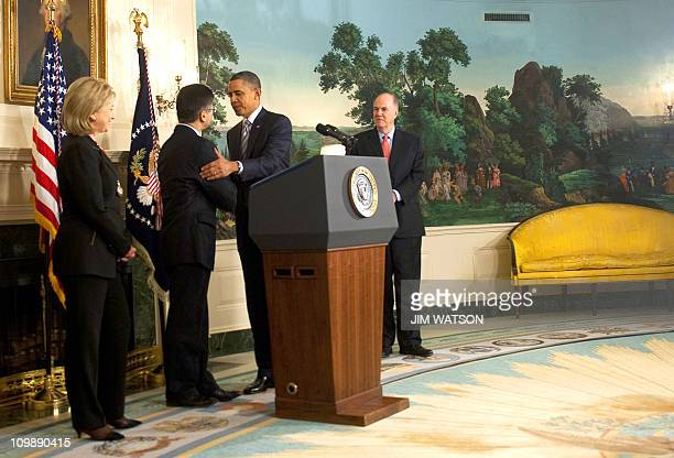 US President Barack Obama shakes hands with US Commerce Seacretary Gary Locke after announcing him as the next US Ambassador to China at the White...