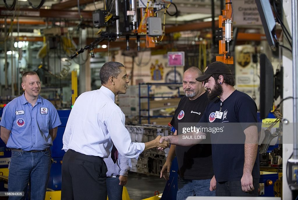 US President Barack Obama shakes hands with workers as they perform work on an engine during a tour of the Daimler Detroit Diesel Plant in Redford, Michigan, December 10, 2012, prior to speaking on...