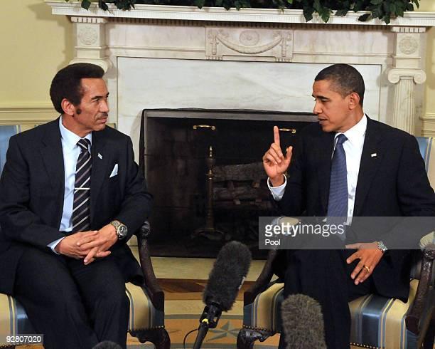 US President Barack Obama shakes meets with President Ian Khama of Botswana in the Oval Office of the White House on November 5 2009 in Washington DC...