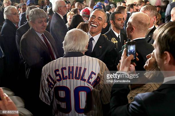 S President Barack Obama shares a laugh with Chicago Cubs fan Frank Alschuler while celebrating the team's World Series championship in the East Room...