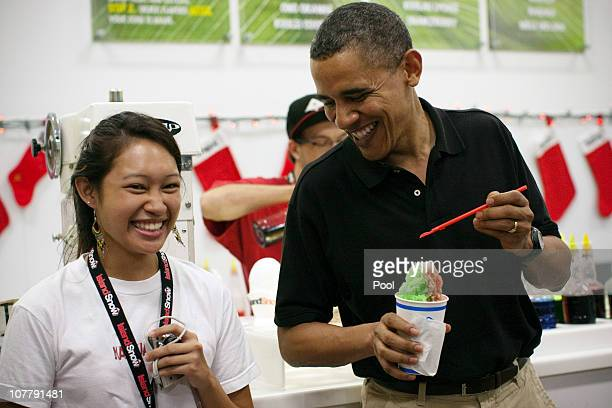 US President Barack Obama shares a laugh with Island Snow store employee Renee at Kailua Beach Center on December 27 2010 in Kailua Hawaii The Obamas...