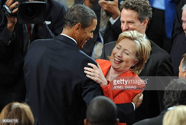US President Barack Obama shares a laugh with Secretary of State Hillary Clinton as he arrives to address a joint session of Congress on his...