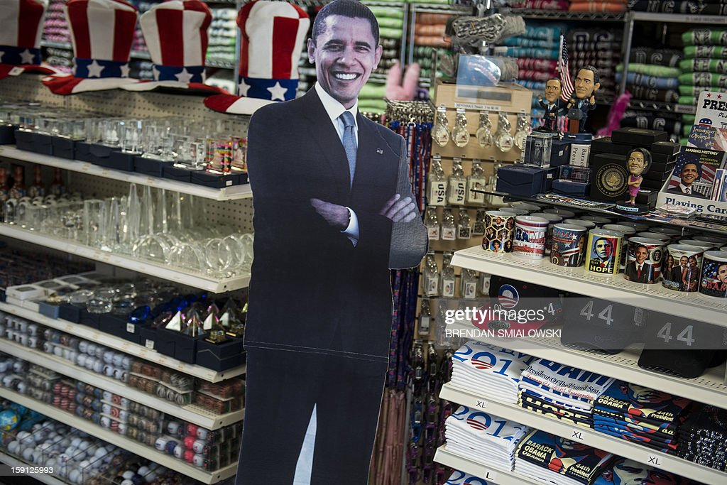 US President Barack Obama shirts and other items are seen at the Souvenir World shop in Washington on January 8, 2013. Preparations continue for Obama's inauguration for his second term on January 21. AFP PHOTO/Brendan SMIALOWSKI