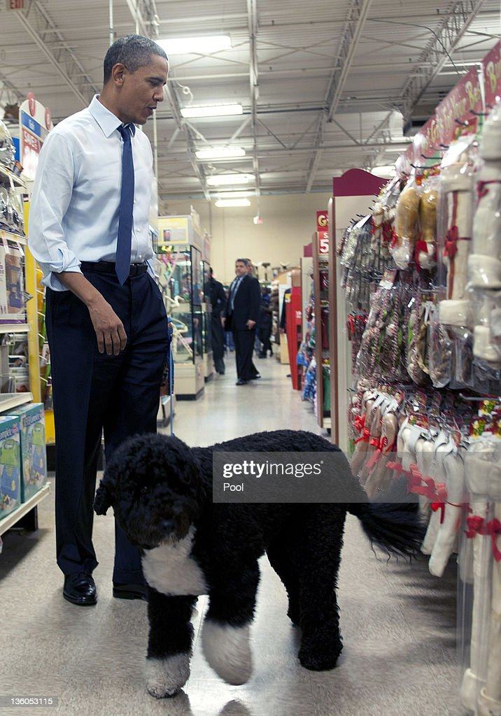 U.S. President Barack Obama shops for Christmas presents with his dog Bo at Petsmart on December 21, 2011 in Alexandria, Virginia. President Obama called on House Speaker Rep. John A. Boehner (R-OH) on to urge him again to allow a vote on a Senate-passed measure that would extend a payroll tax holiday for two months.