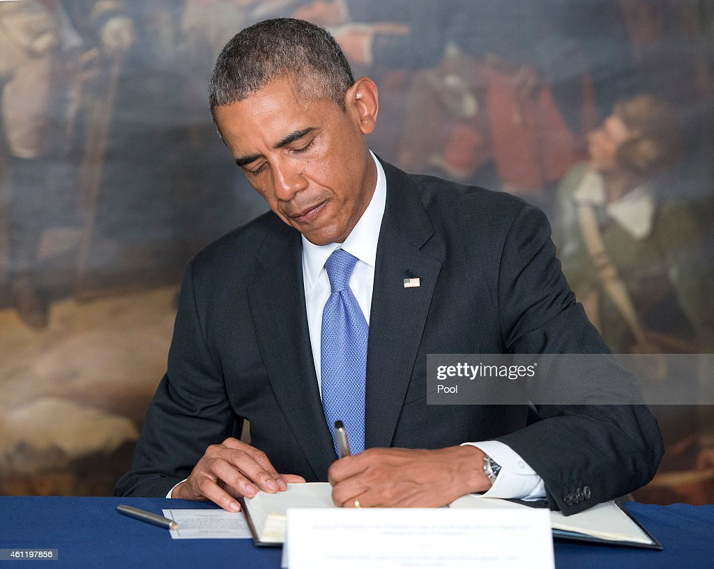 President Barack Obama signs a book of condolence in honor of victims of a terrorist attack January 8, 2015 in Washington D.C. Twelve people were killed, including two police officers, when gunmen opened fire at the offices of the French satirical publication Charlie Hebdo. The President's inscription reads 'On behalf of all Americans, I extend our deepest sympathy and solidarity to the people of France following the terrible terrorist attack in Paris. As allies across the centuries, we stand united with our French brothers to ensure that justice is done and our way of life is defended. We go forward together knowing that terror is no match for freedom and ideals we stand for - ideals that light the world. Vive la France!'