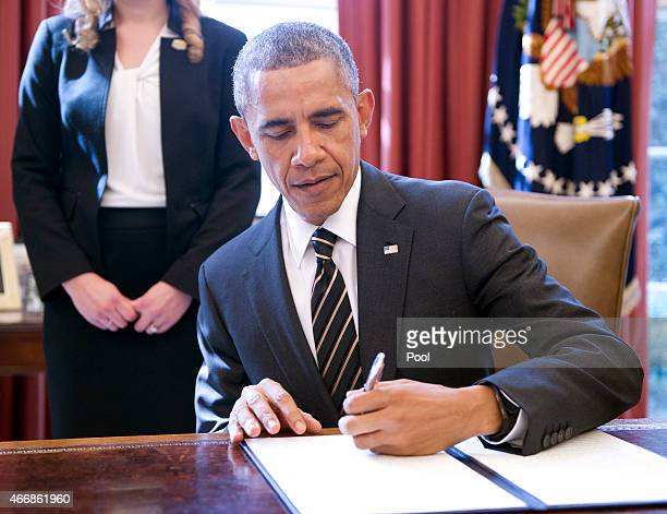 S President Barack Obama signs an Executive Order titled 'Planning for Sustainability in the Next Decade' in the Oval Office of the White House on...