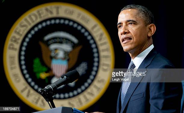 President Barack Obama signs executive orders designed to reduce gun violence in the United States in the Eisenhower Executive Building on January...