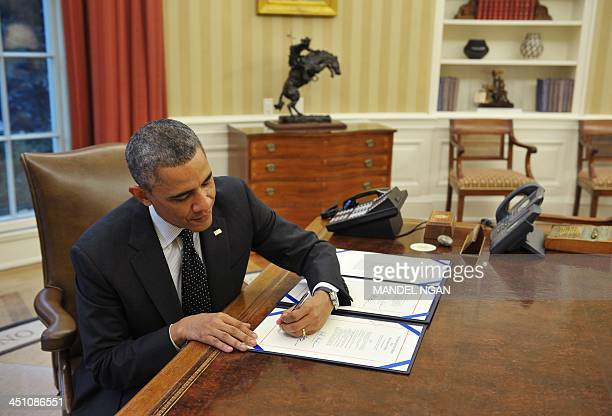 President Barack Obama signs H.R. 2747: Streamlining Claims Processing for Federal Contractor Employees Act, and S. 893: Veterans Compensation...