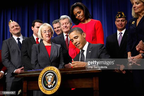 S President Barack Obama signs legislation into law that will provide business tax credits to help put veterans back to work during a ceremony with...