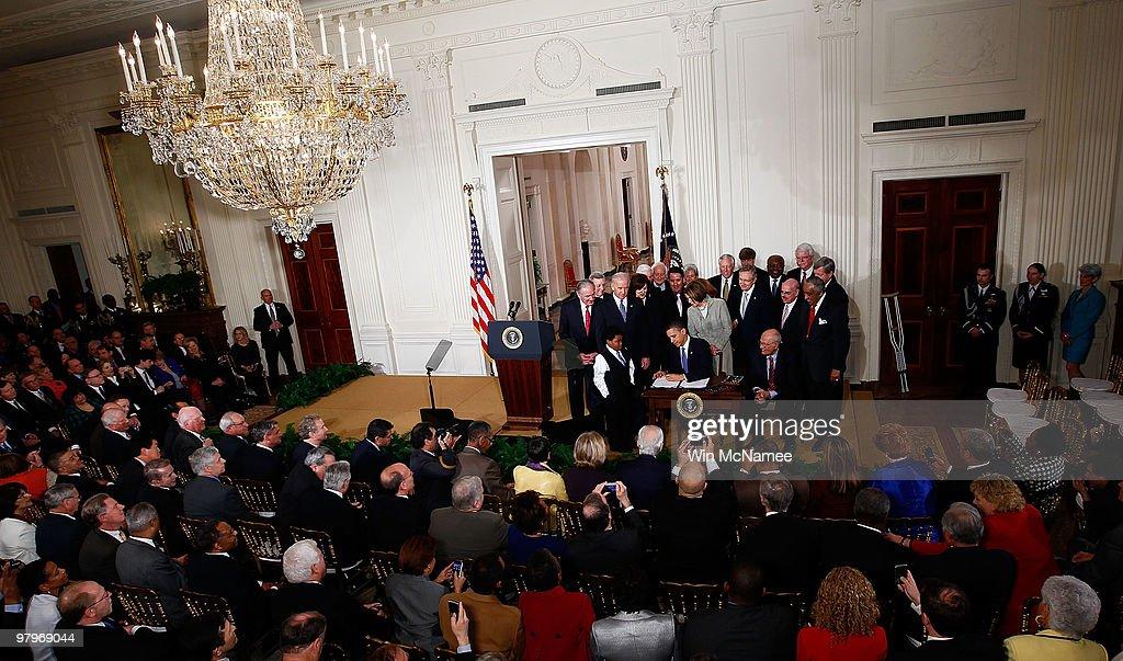 President Obama Signs Health Care Reform Bill : News Photo