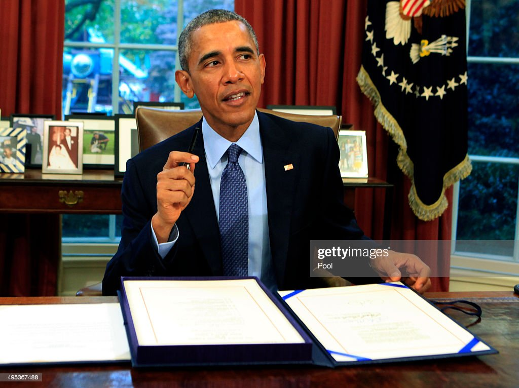 U.S. President Barack Obama signs the bipartisan budget bill 2015 into law in the Oval Office of the White House November 2, 2015 in Washington, DC. Obama is traveling to New Jersey where he will talk about criminal justice reform and re-entry for formerly jailed people and he will later travel to New York for Democratic fund raisers.