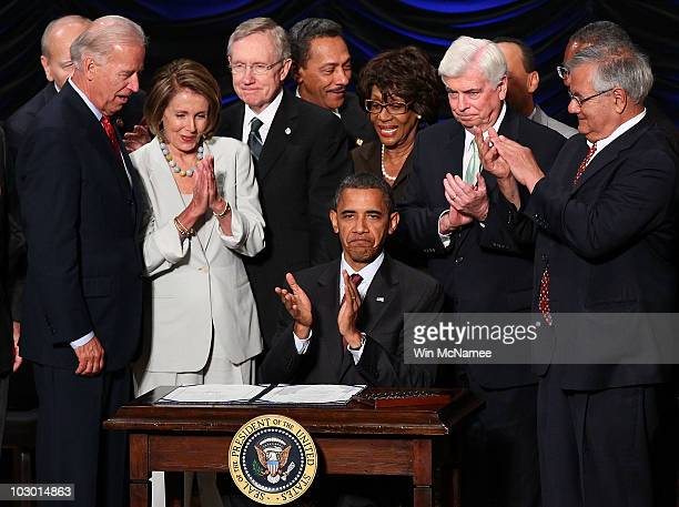 S President Barack Obama signs the DoddFrank Wall Street Reform and Consumer Protection Act before Vice President Joe Biden Speaker of the House...