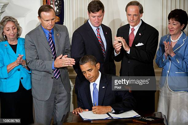 President Barack Obama signs the Improper Payments Elimination and Recovery Act before Rep. Patrick Murphy , Sen. Tom Carper and Sen. Susan Collins...