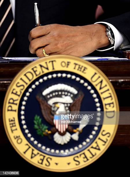 S President Barack Obama signs the STOCK Act into law at the Eisenhower Executive Office Building April 4 2012 in Washington DC The STOCK Act is a...