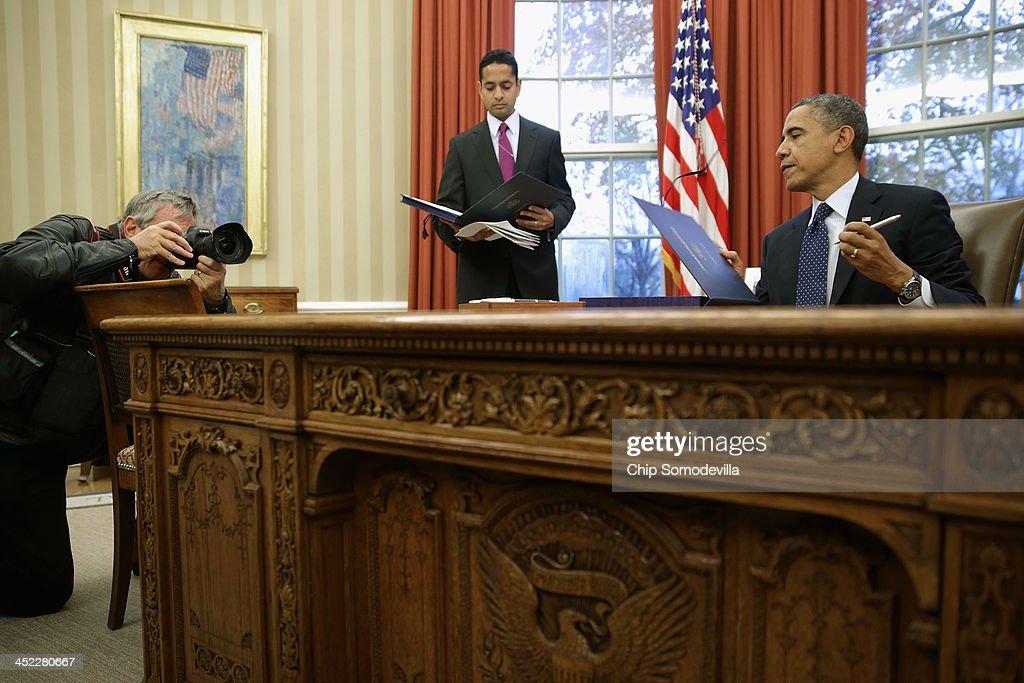 U S President Barack R Signs Three Bills Into Law On The Resolute Desk
