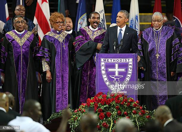 S President Barack Obama sings Amazing Grace as he delivers the eulogy for South Carolina state senator and Rev Clementa Pinckney during Pinckney's...