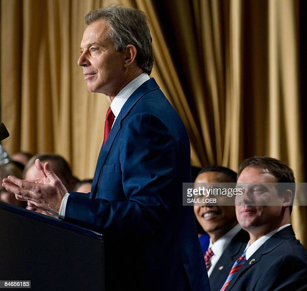 US President Barack Obama sits alongside Democrat North Carolina Representative Heath Shuler as former British Prime Minister Tony Blair speaks...