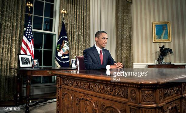 US President Barack Obama sits behind his desk after addressing the nation from the Oval Office of the White House August 31 2010 in Washington DC In...