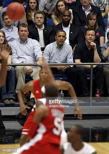 President Barack Obama sits with British Prime Minister David Cameron at UD Arena to watch the Western Kentucky Hilltoppers take on the Mississippi...