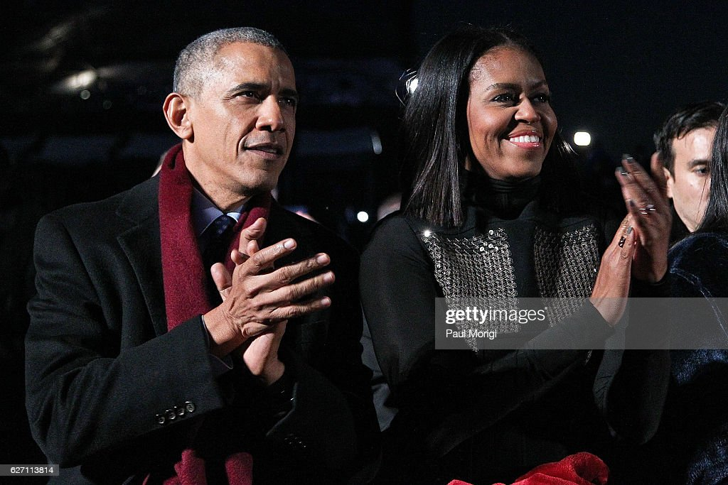 President Barack Obama sits with first lady Michelle Obama to watch musical perfomances during the 94th Annual National Christmas Tree Lighting Ceremony on the Ellipse in PresidentÕs Park on December 1, 2016 in Washington, DC.