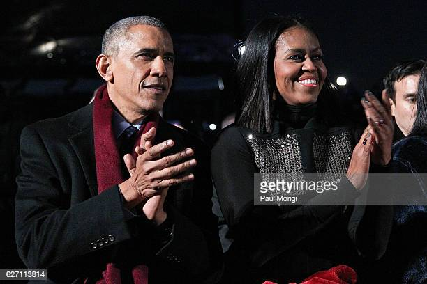 President Barack Obama sits with first lady Michelle Obama to watch musical perfomances during the 94th Annual National Christmas Tree Lighting...