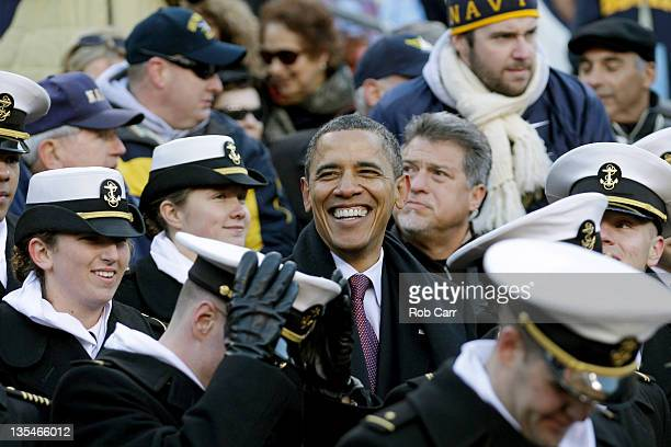S President Barack Obama sits with Navy Midshipmen while watching the112th annual ArmyNavy Game at FedEx Field on December 10 2011 in Landover...