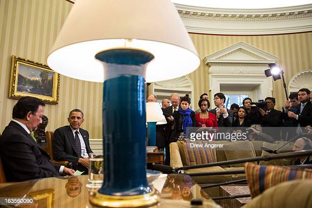 S President Barack Obama sits with Sultan Haji Hassanal Bolkiah of Brunei at the end of a bilateral meeting in the Oval Office at the White House on...