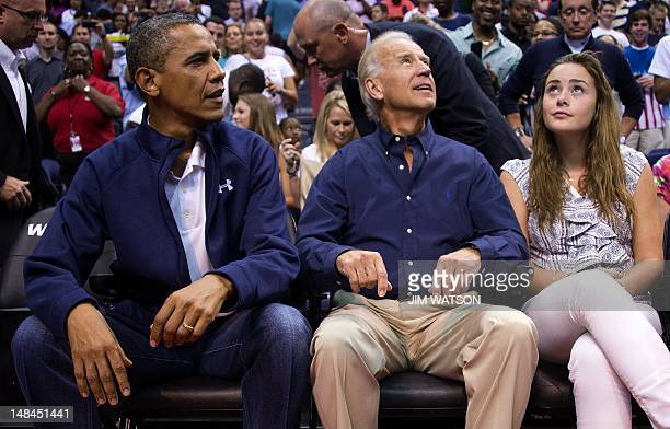 US President Barack Obama sits with US Vice President Joe Biden and his granddaughter Naomi Biden during the Men's USA Basketball vs Brazil game at...