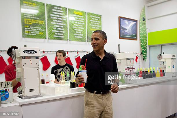 US President Barack Obama smiles after receiving his Shave Ice with cherry lemon lime and Melona flavors at Island Snow at Kailua Beach Center on...