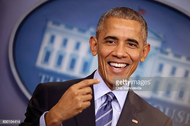 S President Barack Obama smiles as he answers questions during a news conference in the Brady Press Breifing Room at the White House December 16 2016...