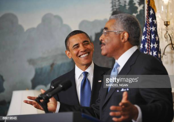 US President Barack Obama smiles as he is being introduced by American Association of Retired Persons CEO Barry Rand before speaking on lower drug...