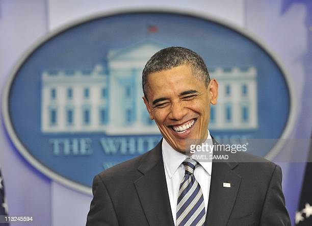 US President Barack Obama smiles as he makes a statement on his birth certificate at the White House in Washington DC on April 27 2011 Obama said...