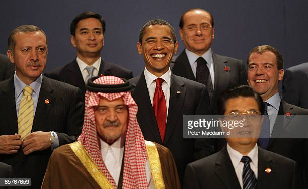 President Barack Obama smiles as he poses for a group photograph with Turkish Prime Minister Recep Tayyip Erdogan, Thailands Prime Minister, Abhisit...