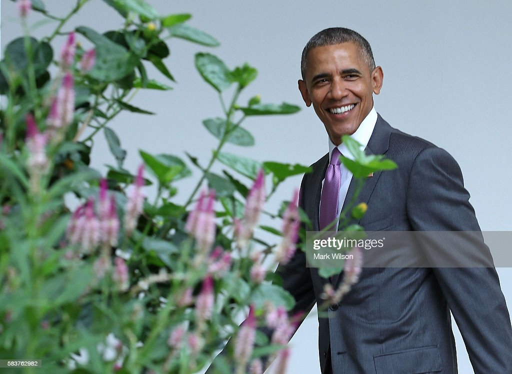 US President Barack Obama smiles as he walks across the colonnade toward the Oval office July 27, 2016 in Washington, DC. Later tonight President Obama will travel to Philadelphia to speak at the DNC convention.