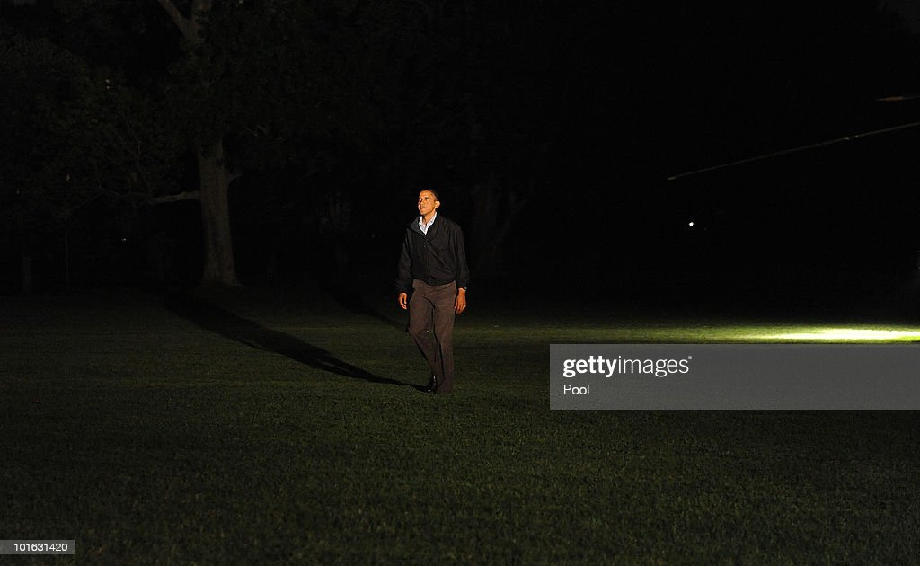 U.S. President Barack Obama smiles at his family as he walks on the South Lawn of the White House upon his return June 4, 2010 to Washington, DC. The president was returning from a day trip to the Louisiana Gulf Coast where he observed ongoing efforts to contain the Deepwater Horizon oil spill that continues to spew millions of gallons of crude oil.