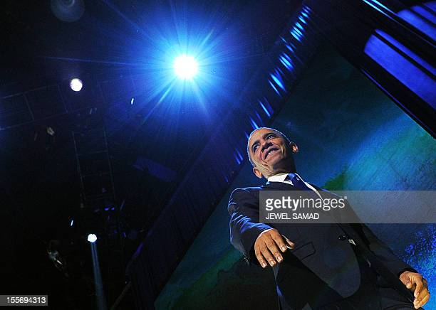 US President Barack Obama smiles at supporter after delivering his victory speech on election night in Chicago on November 7 2012 Obama swept to...