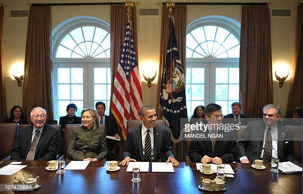 US President Barack Obama smiles at the start of a cabinet meeting December 8 2010 in the Cabinet Room of the White House in Washington DC From left...