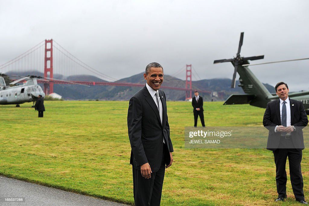 US President Barack Obama smiles before boarding Marine One helicopter from a field overlooking the iconic golden gate bridge in San Francisco, California, on April 4, 2013. Obama is in California to attend two DCCC fund rising events. AFP PHOTO/Jewel Samad