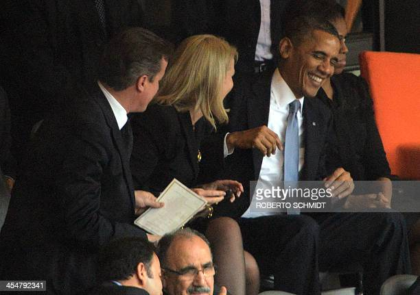 US President Barack Obama smiles before posing for a selfie picture with British Prime Minister David Cameron and Denmark's Prime Minister Helle...