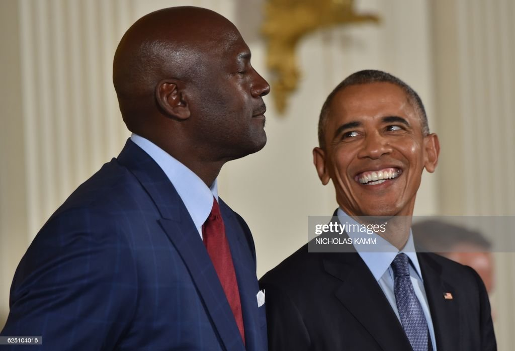 President Barack Obama smiles before presenting former NBA basketball player Michael Jordan with the Presidential Medal of Freedom, the nation's highest civilian honor, during a ceremony honoring 21 recipients, in the East Room of the White House in Washington, DC, November 22, 2016. / AFP PHOTO / Nicholas Kamm