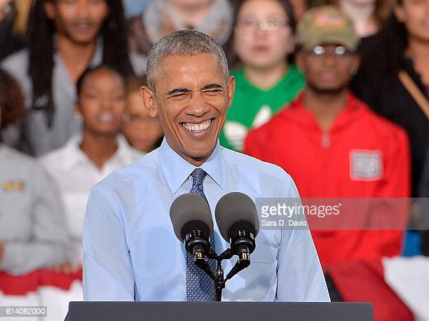 S President Barack Obama smiles during a campaign event for Democratic presidential nominee Hillary Clinton on October 11 2016 in Greensboro North...